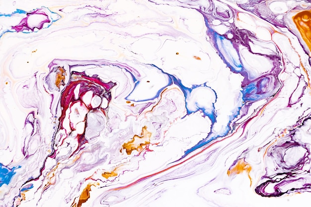 Abstract acrylic liquid texture. modern artwork with spots and splashes of color paint.