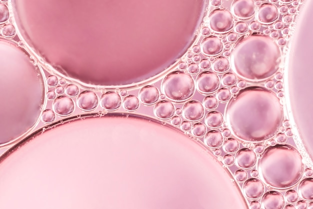 Abstract air bubbles in liquid on rose blurred background