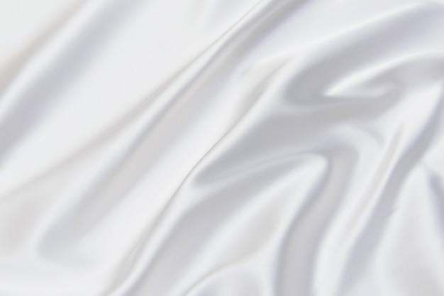 白い布の背景、白いテクスチャと詳細の抽象的でソフトフォーカスの波