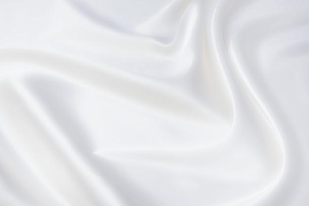 Абстрактная и мягкая волна фокусировки из белой ткани фона, белой текстуры и деталей