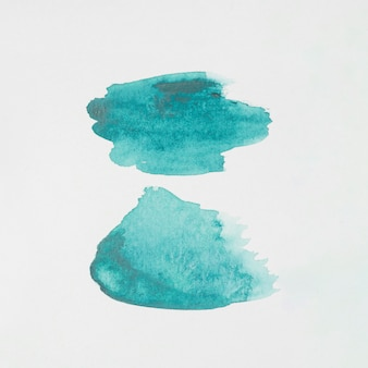 Abstract aquamarine spots of paints on white paper