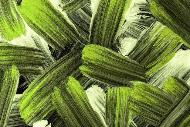 추상 미술 배경 검정과 밝은 녹색 색상입니다. 획과 스플래시가 있는 수채화. 얼룩무늬가 있는 종이에 아크릴 올리브 삽화. 질감 배경입니다.