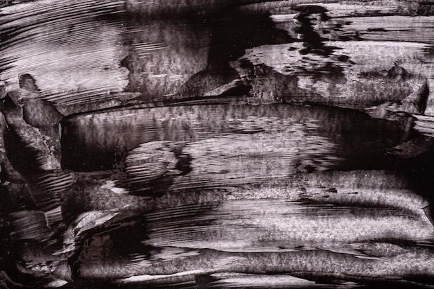 抽象芸術の背景の黒と白の色。灰色のストロークとスプラッシュとキャンバス上の水彩画。ブラシストロークパターンの紙にアクリルアートワーク。石の背景。