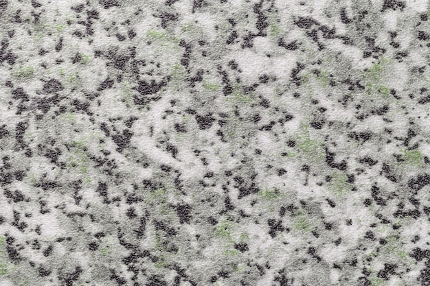 Abstract art background black, white and gray color. texture of stone tabletop and countertop with green blotches