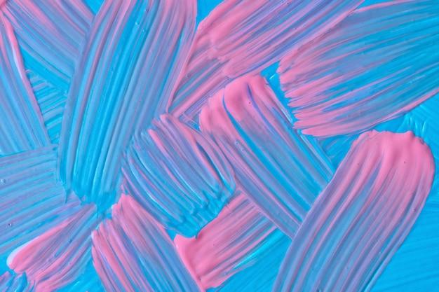 추상 미술 배경 파란색과 밝은 분홍색 색상입니다. 청록색 선과 스플래시가 있는 캔버스에 수채화 그림. 점박이 패턴이 있는 종이에 아크릴 아트웍입니다. 질감 배경입니다.