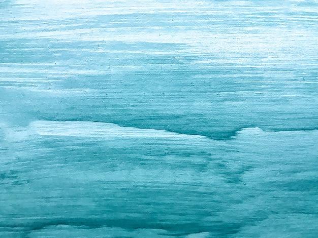抽象芸術の背景の青と白の色。ターコイズのグラデーションでキャンバスに水彩画。ブラシストロークパターンのアクリルテクスチャ背景。