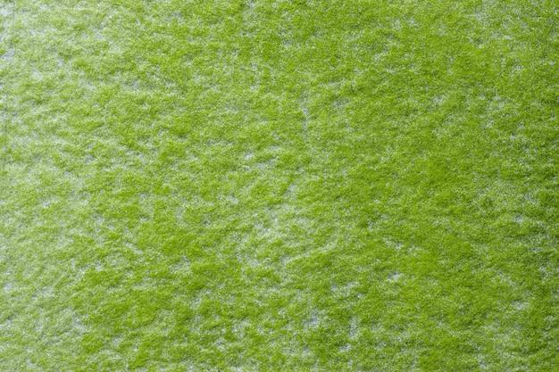 抽象芸術の背景の明るい緑と白の色。キャンバスに水彩画。