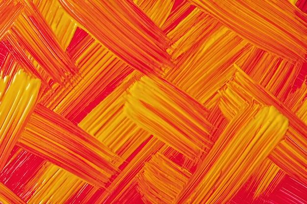 抽象芸術の背景の明るい赤と黄色の色。オレンジ色のストロークとスプラッシュとキャンバス上の水彩画。生姜のブラシストロークパターンで紙にアクリルアートワーク。テクスチャの背景。