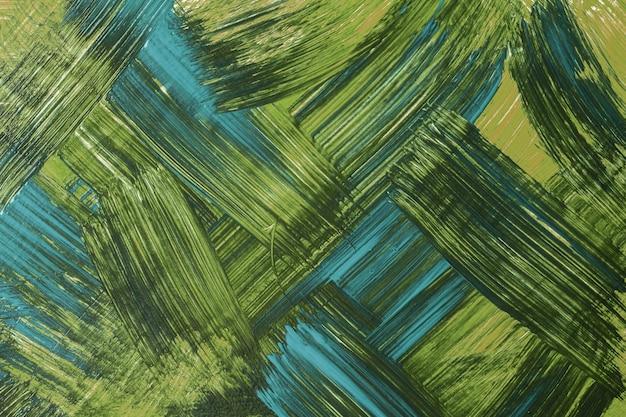 추상 미술 배경 짙은 녹색과 파란색입니다. 획과 스플래시가 있는 캔버스에 수채화 그림. 올리브 얼룩 무늬가 있는 종이에 아크릴 아트웍입니다. 질감 배경입니다.