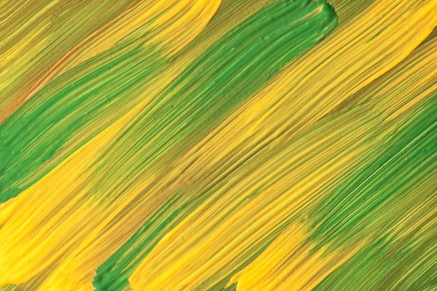 추상 미술 배경 짙은 녹색, 황금색 및 노란색 색상. 획과 스플래시가 있는 수채화. 브러시 스트로크 패턴이 있는 종이에 아크릴 아트웍입니다. 질감 배경입니다.