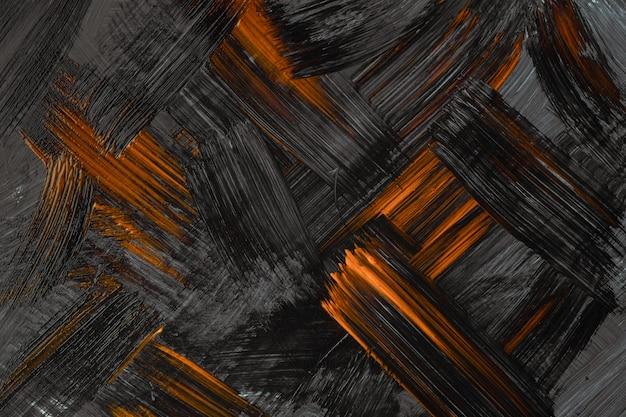 抽象芸術の背景の濃いオレンジと黒の色。灰色のストロークとスプラッシュとキャンバス上の水彩画。ブラシストロークパターンの紙にアクリルアートワーク。テクスチャの背景。