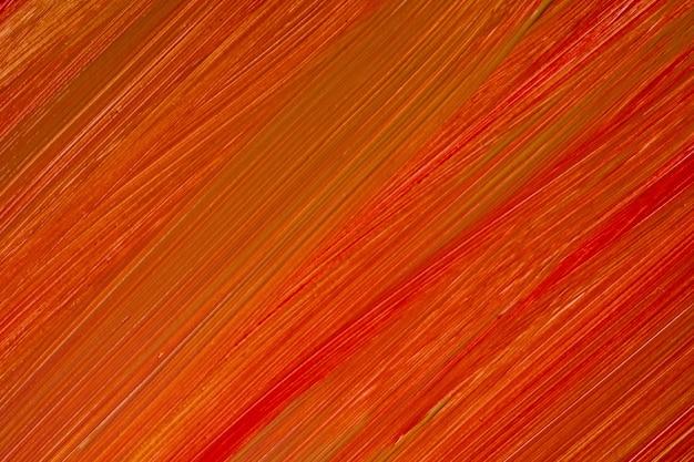 抽象芸術の背景の濃いオレンジと赤の色。生姜のストロークとスプラッシュとキャンバスに水彩画。斑点模様の紙にアクリルアートワーク。テクスチャの背景。