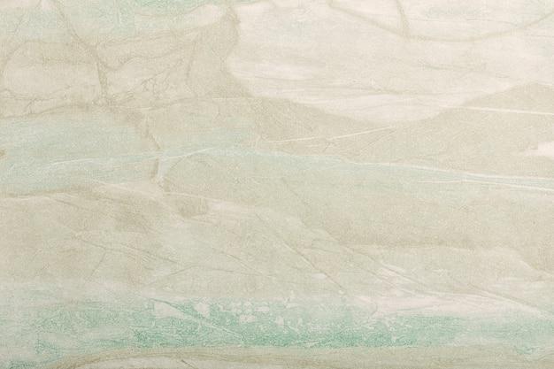 抽象芸術の背景ライトベージュと緑の色。ソフトオリーブのグラデーションでキャンバスに水彩画。