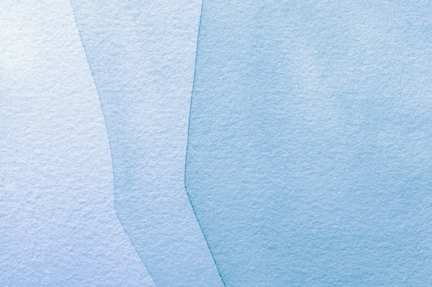 Abstract art background light blue colors. watercolor painting on canvas with denim gradient.