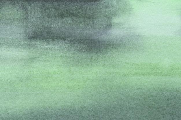 抽象芸術の背景の明るい緑とシアンの色。柔らかいオリーブグラデーションのキャンバスに水彩画。