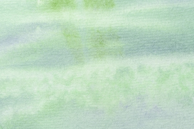 Abstract art background light green and blue colors. watercolor painting on canvas with soft olive gradient.