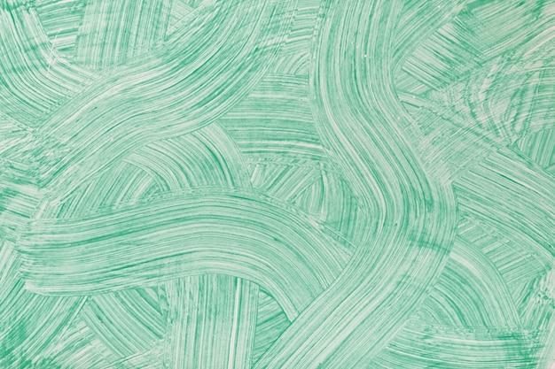 추상 미술 배경 밝은 녹색 색상. 청록색 선과 스플래시가있는 캔버스에 수채화 그림