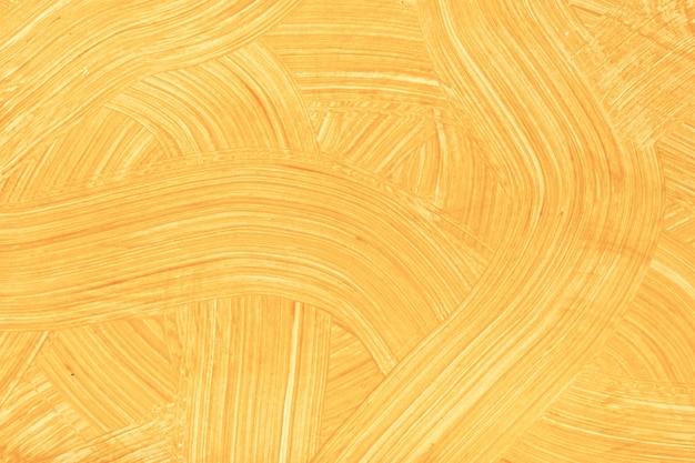 Абстрактное искусство фон светло-оранжевого цвета. акварельная живопись на холсте с золотыми мазками и всплесками