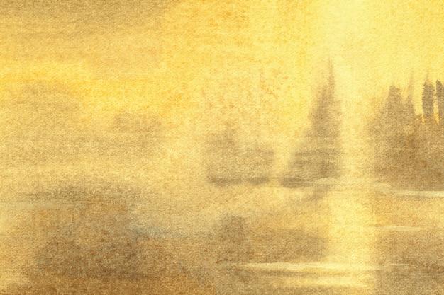 抽象芸術の背景の明るい黄色と黄金色。柔らかい黄土色のグラデーションでキャンバスに水彩画。
