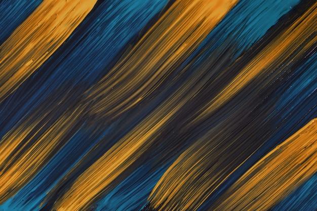 抽象芸術の背景ネイビーブルーとダークゴールデンの色。黄色のストロークとスプラッシュとキャンバス上の水彩画。斑点模様の紙にアクリルアートワーク。テクスチャの背景。