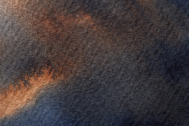 抽象芸術の背景ネイビーブルーとオレンジ色。茶色の染みとグラデーションの粗い紙に水彩画。