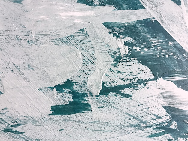 추상 미술 배경 네이비 블루와 화이트 색상입니다. 에메랄드 그라데이션으로 캔버스에 수채화 그림입니다. 튄 패턴으로 아크릴 질감 배경입니다.
