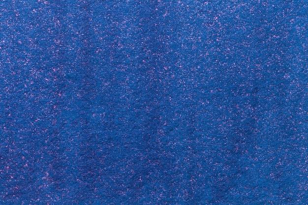 抽象芸術の背景ネイビーブルーの色。ラフ紙に水彩画
