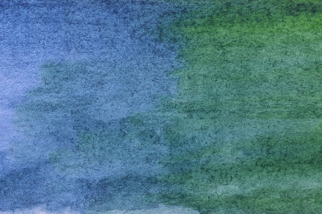 Abstract art background navy blue and green colors. watercolor painting on paper with cyan gradient.