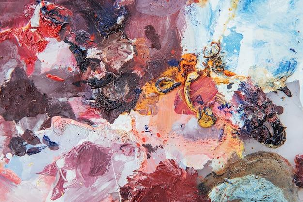 抽象芸術の背景。キャンバスに油彩画。色とりどりの明るい質感。アートワークの断片。オイルペイントの斑点。ペイントの筆。