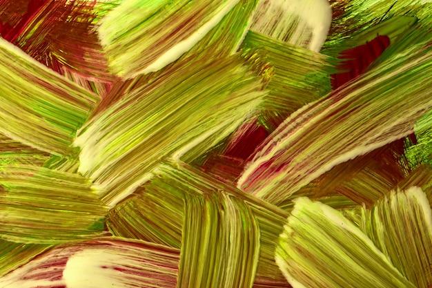 抽象芸術の背景の赤と薄緑の色。ストロークとスプラッシュの水彩画。斑点模様の紙にアクリルオリーブのアートワーク。テクスチャの背景。