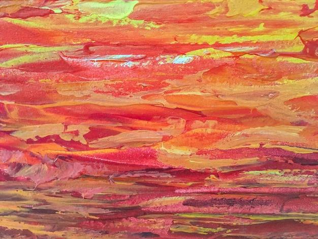 抽象芸術の背景の赤とオレンジ色。