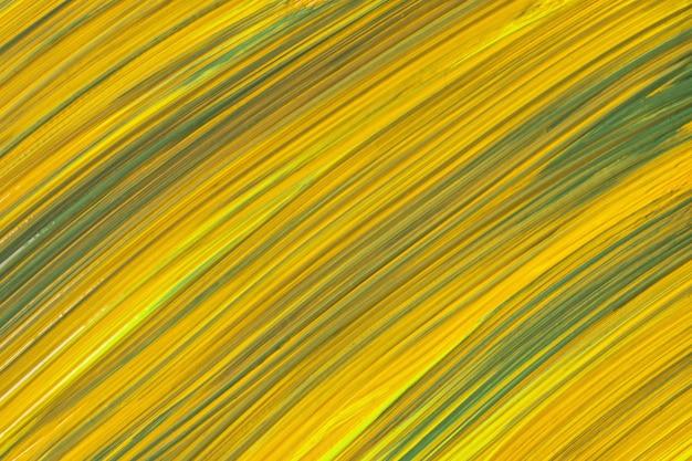 추상 미술 배경 노란색과 녹색 색상입니다. 호박색 선과 스플래시가 있는 캔버스에 수채화 그림. 점박이 패턴이 있는 종이에 아크릴 아트웍입니다. 질감 배경입니다.