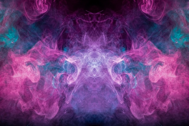 Abstract art colored smoke on black isolated background.