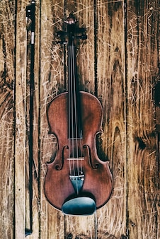The abstract art desig nbackground of wooden violin and bow put