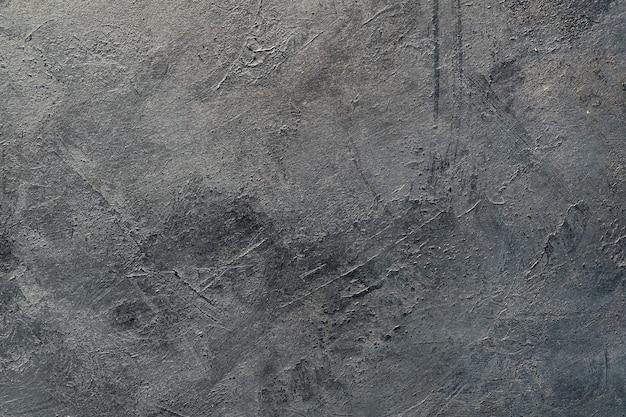 Абстрактное искусство серый черный текстурированный фон.