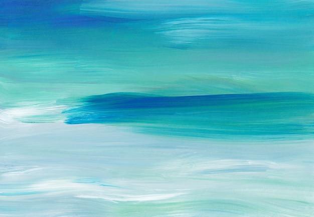 Абстрактный художественный фон, синие, бирюзовые и белые мазки на бумаге