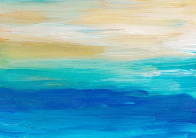 Абстрактный художественный фон, мазки кистью синий, бирюзовый, желтый, белый на бумаге