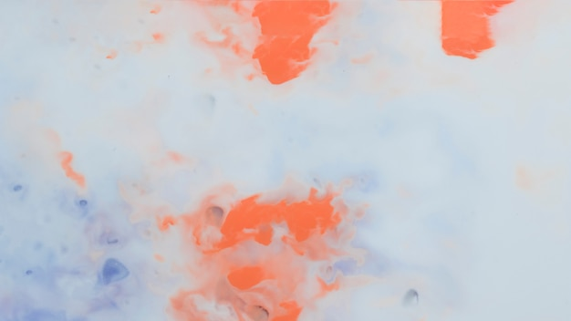 Abstract artistic orange and blue paint background