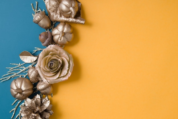 Abstract autumn background with golden pumpkins leaves acorns on colored paper backdrops with copy s...