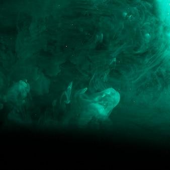 Abstract azure haze in darkness