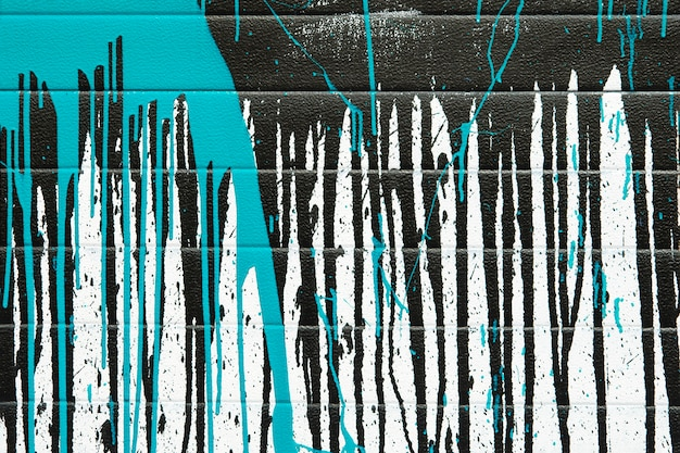 Abstract background of blue and black paint splashes