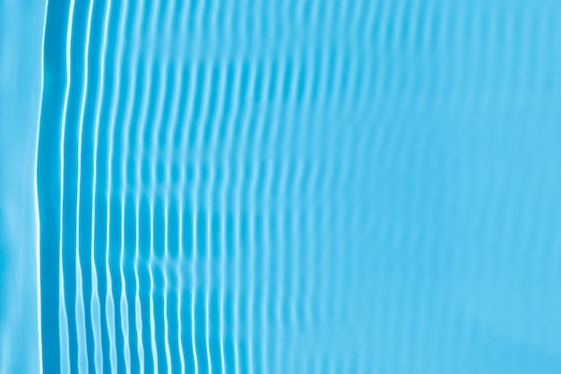 Abstract background of blue water under sunlight. top view, flat lay.