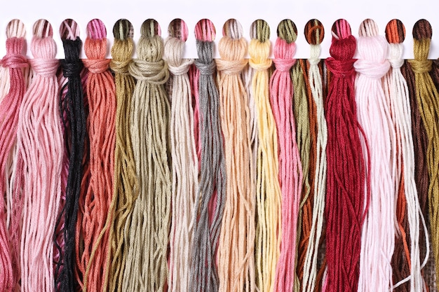 Abstract background of colored threads for cross stitch