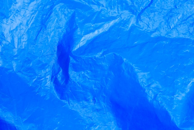 Abstract background crumpled plastic film texture blue garbage bag