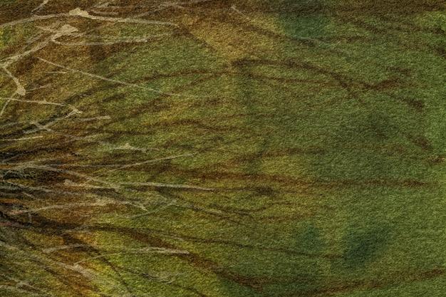 抽象的な背景の濃い緑とオリーブ色。茶色の線とグラデーションでキャンバスに水彩画。