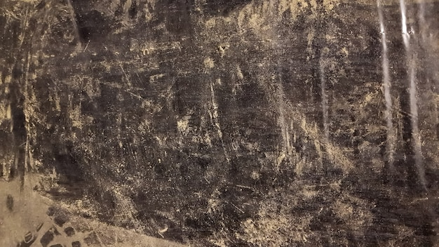 Abstract background of dirty black polyethylene in the dust. copy space.