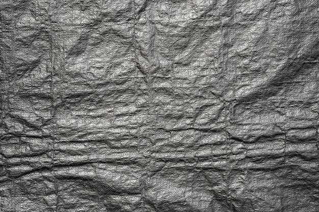 Abstract background from black plastic bag texture with grunge