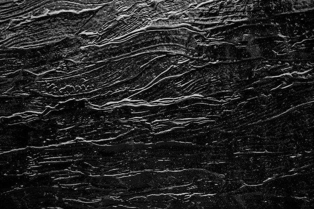 Abstract background from black rock texture plate decorated on wall