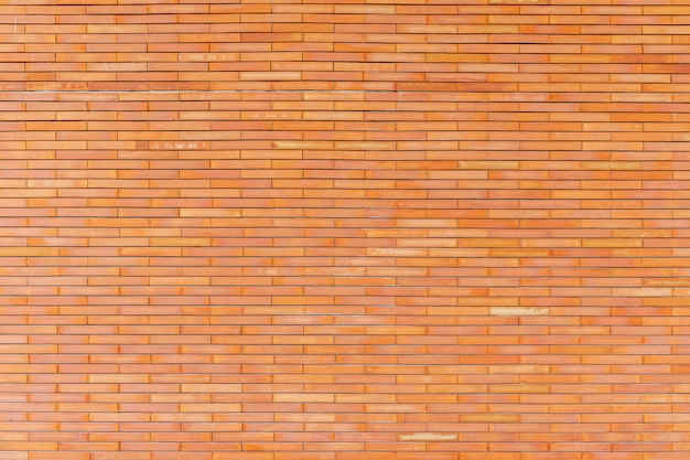 壁に茶色のレンガパターンから抽象的な背景。