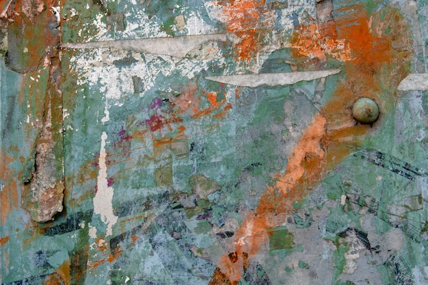 Abstract background from colorful wall with torn sticker paper.